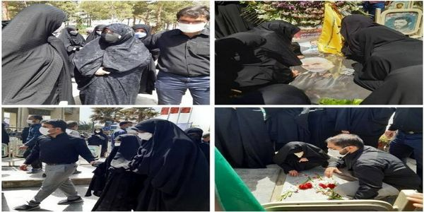 تصویری از خانواده سردار حجازی در مراسم تدفین
